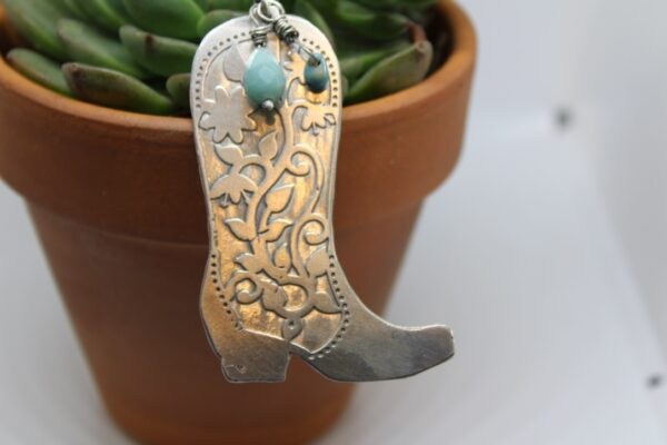 This Sterling Silver etched Cowboy Boot is 2 3/4 long with a 30 inch 3.7mm Sterling Silver Rolo chain.